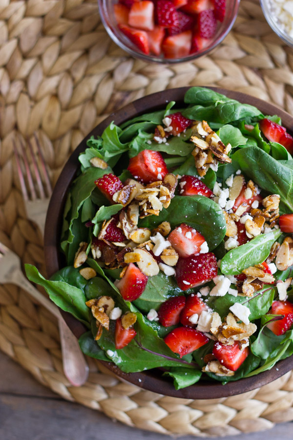 Strawberry and Spinach Salad with Almond Vinaigrette in a bowl.