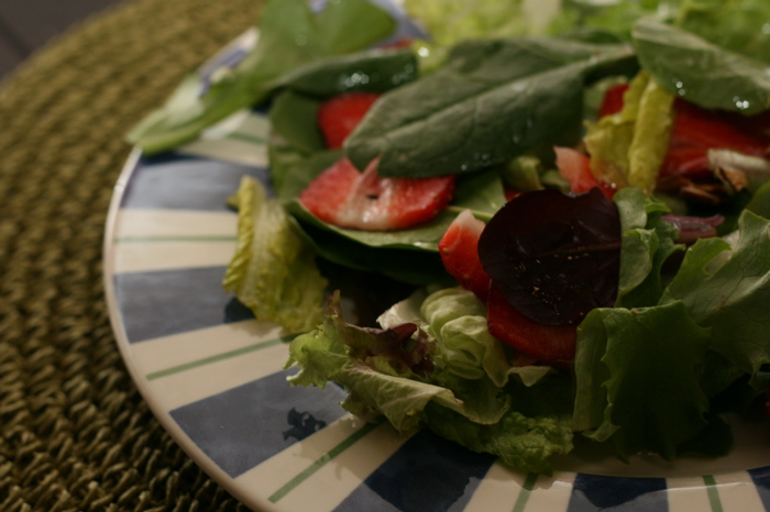 Strawberry and Spinach Salad with Almond Vinaigrette on a plate.