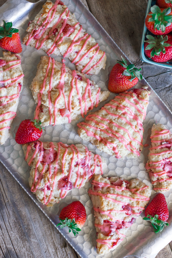 Dreamy Strawberries & Cream Scones on a serving platter with whole strawberries.