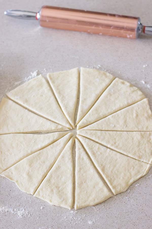 The Best Butterhorn Rolls dough cut into wedges.