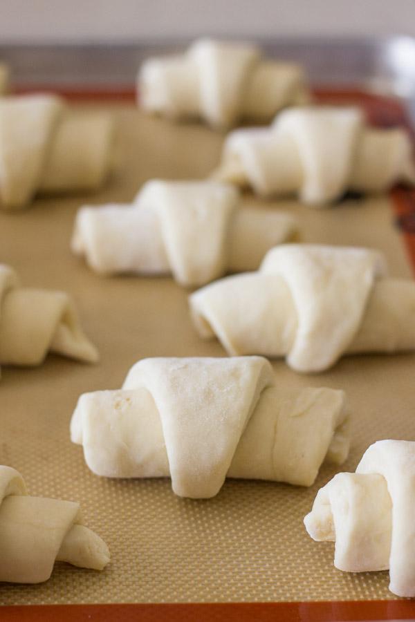 The Best Butterhorn Rolls dough on a Silpat lined baking sheet.