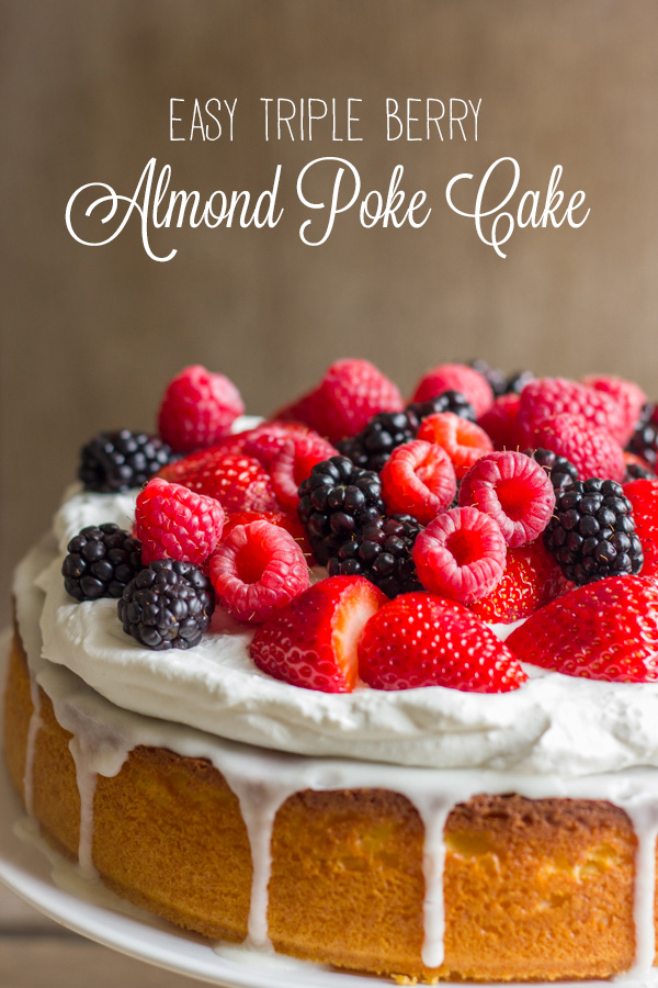 Easy Triple Berry Almond Poke Cake on a cake stand.
