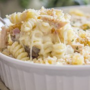 Chicken Cordon Bleu Pasta Bake - creamy pasta, melty swiss cheese, chicken, and ham all baked together and topped with homemade breadcrumbs.