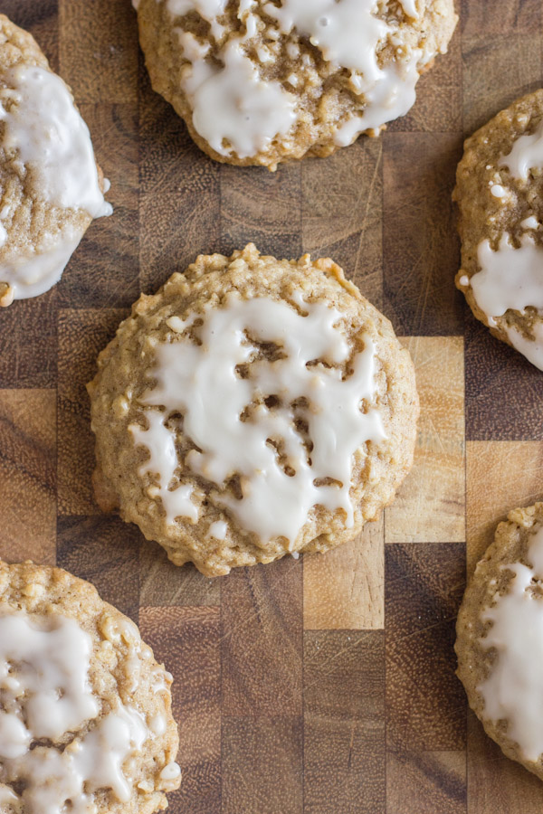 Maple Iced Oatmeal Cookies on a cutting board.