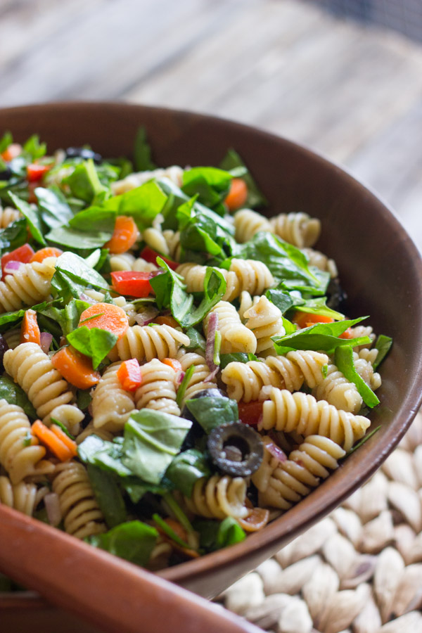 Chopped Spinach and Pasta Salad With Balsamic Vinaigrette in a large wooden bowl.