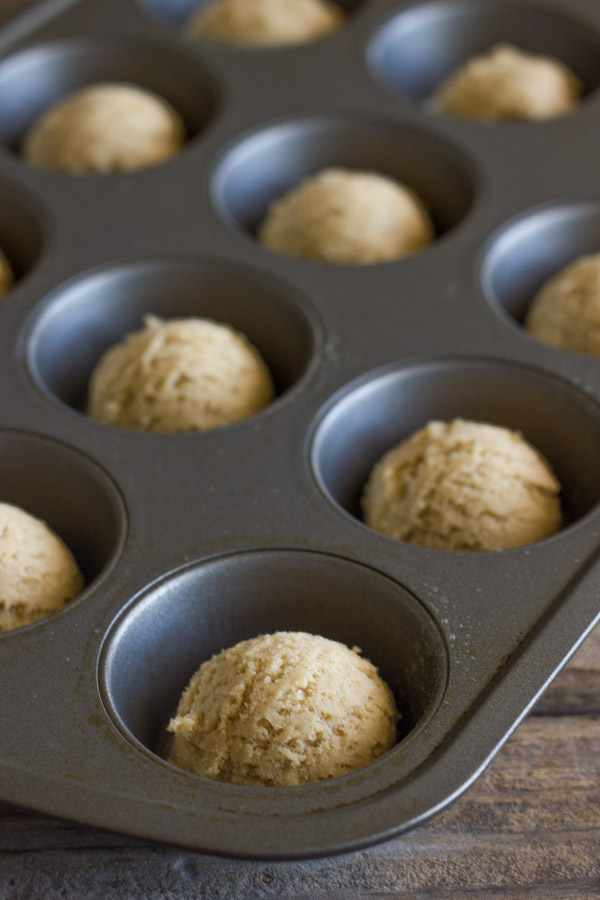Dough balls for the Ice Cream Sundae Cookie Cups in a muffin tin.