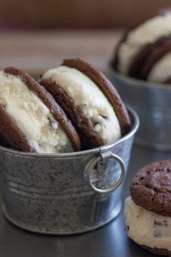 Mint Chip Oreo Ice Cream Sandwiches in galvanized buckets and one Mint Chip Oreo Ice Cream Sandwich next to the bucket.