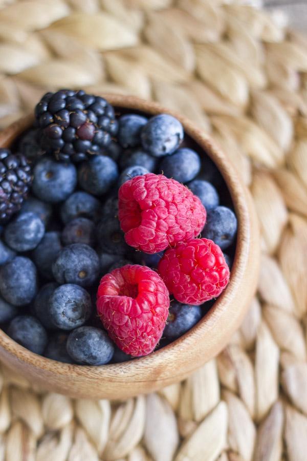 A bowl of blueberries, blackberries and raspberries.