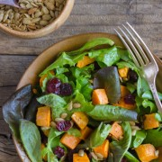 Roasted Sweet Potato Salad - roasted sweet potatoes, dried cranberries, and sunflower seeds on mixed baby greens.