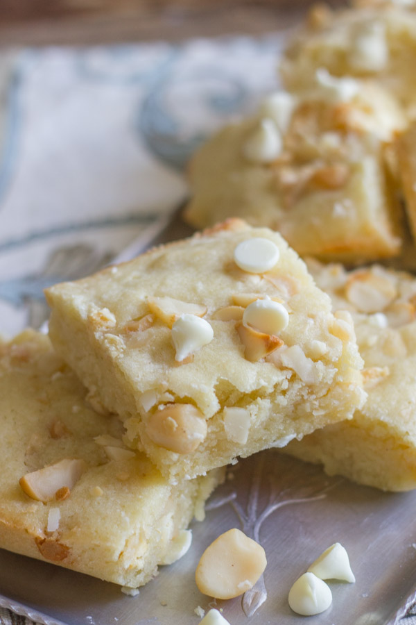 White Chocolate Macadamia Nut Bars arranged on a serving platter.