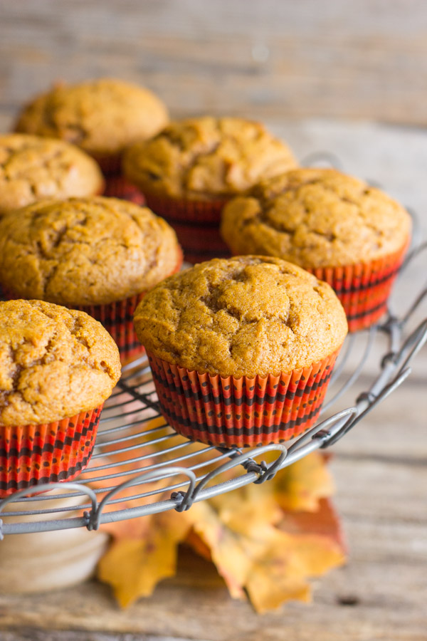 Best Ever Pumpkin Muffins on a metal cake stand.