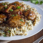 Creamy Balsamic Skillet Chicken - Rich, flavorful, boneless chicken thighs served over rice with a creamy balsamic sauce you'll love!