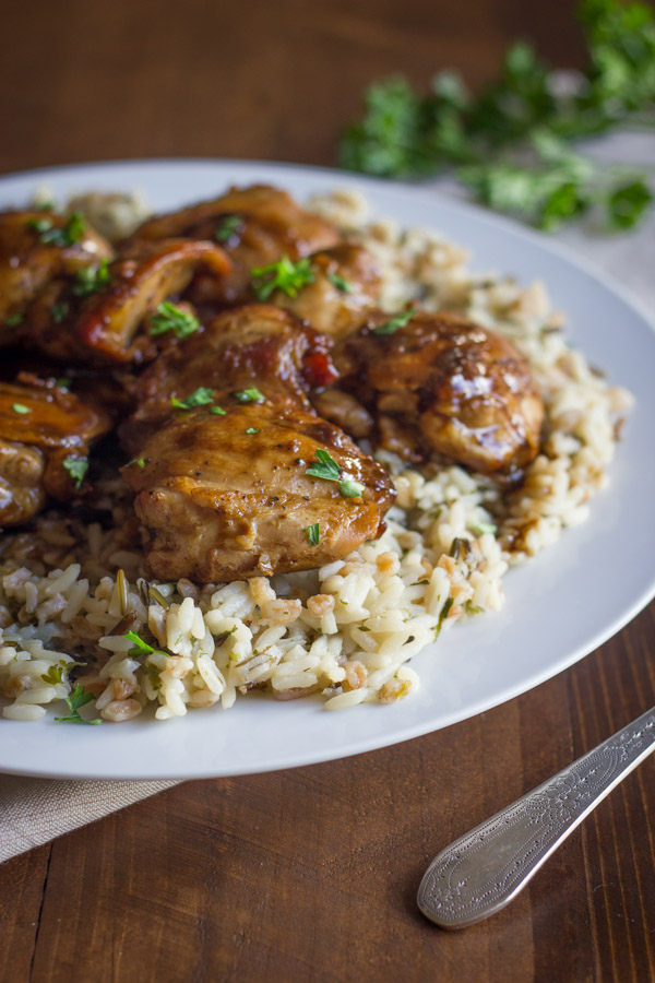 Creamy Balsamic Skillet Chicken served over rice on a plate.