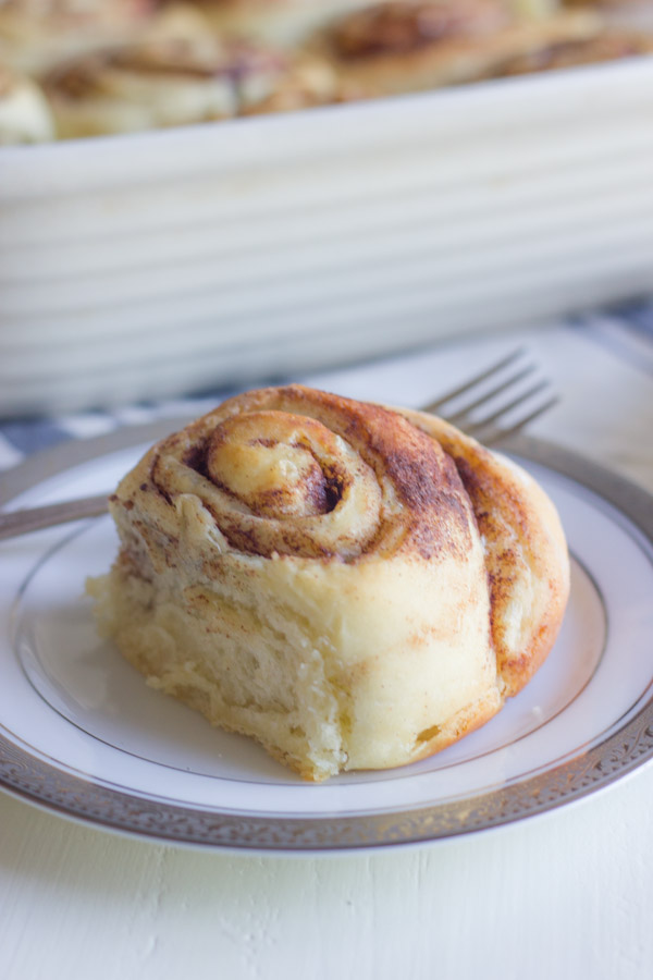 Overnight Cinnamon Roll on a plate with a fork.