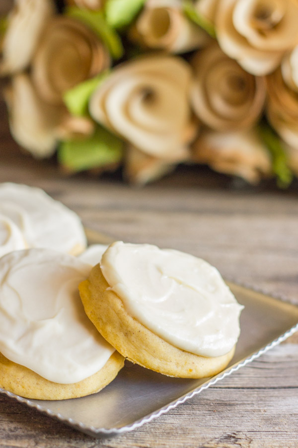 Soft Pumpkin Cookies With Maple Cream Cheese Frosting on a serving platter.
