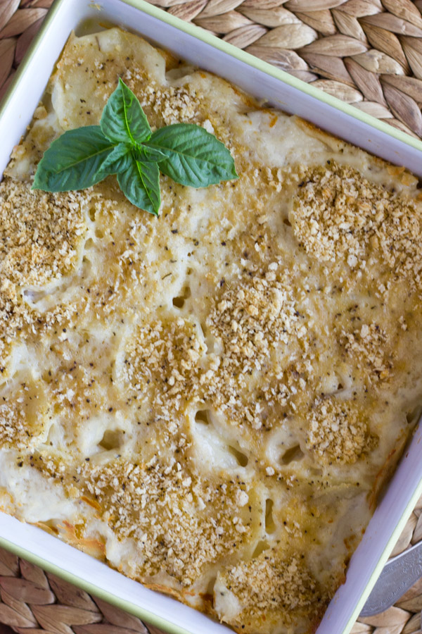 Roasted Garlic Scalloped Potatoes in a square baking dish.