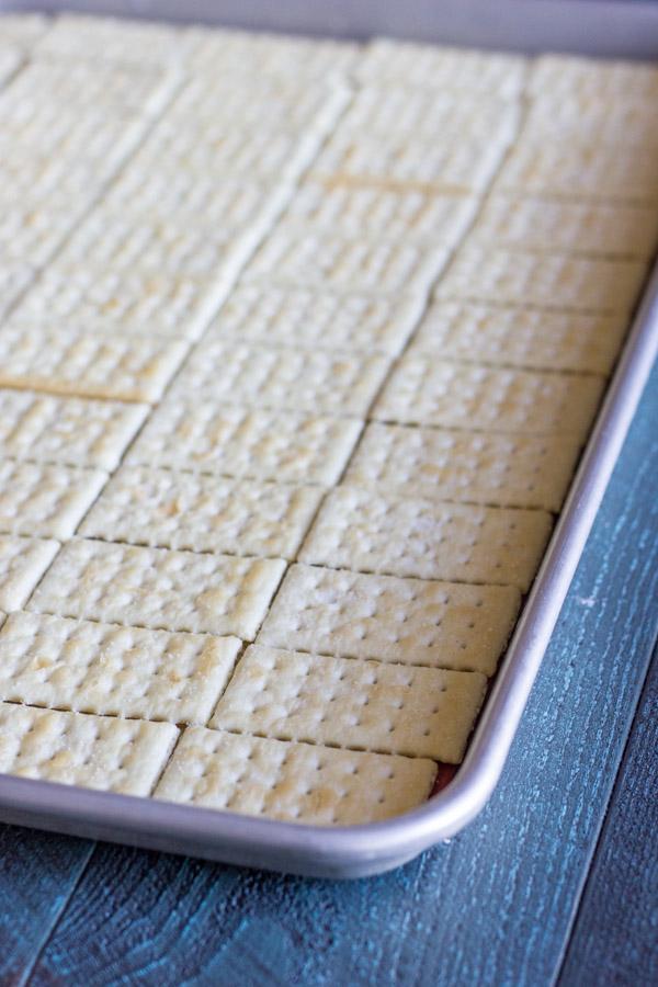 Butter Crackers arranged on a baking sheet.