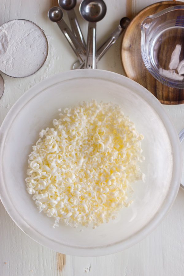 Pie Crust Tutorial Step 1 - grated butter in a bowl.