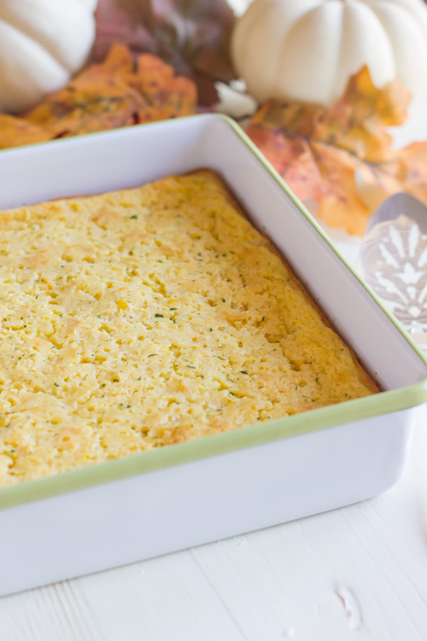 Easy Corn Soufflé in a square baking dish.