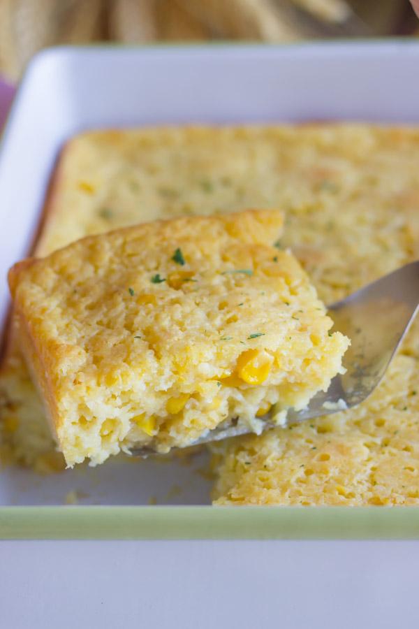 Easy Corn Soufflé on a serving spoon.