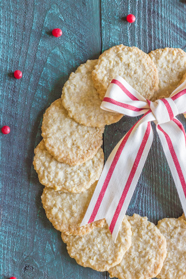 Christmas Oatmeal Cookies arranged in a circle to look like a wreath with a white and red striped bow.