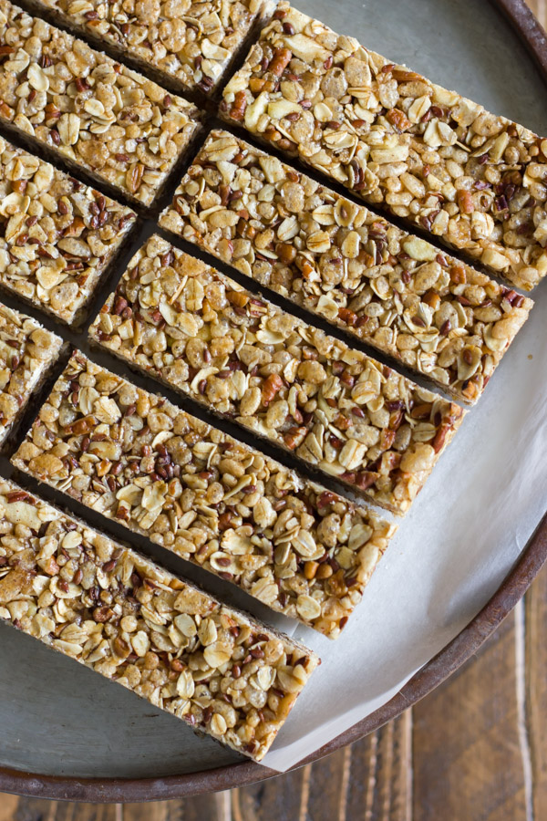 Healthy Chewy Apple Cinnamon Granola Bars on a piece of parchment paper.
