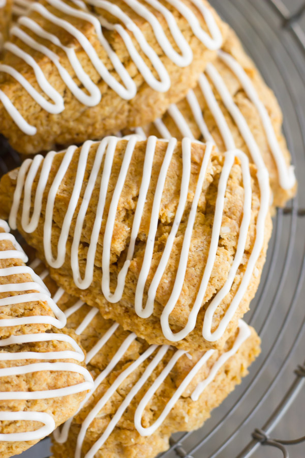 Iced Gingerbread Oat Scones on a cake stand.