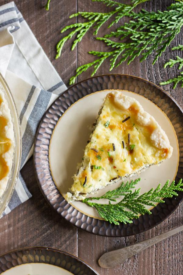 Cheesy Wild Rice Quiche slice on a plate.