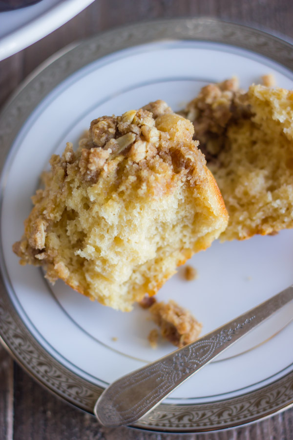 Healthier Cinnamon Oat Streusel Muffin cut open on a plate.