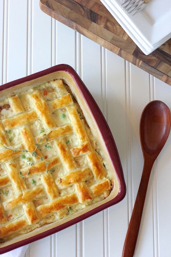 A top down view of a chicken pot pie with a puff pastry lattice crust on top.