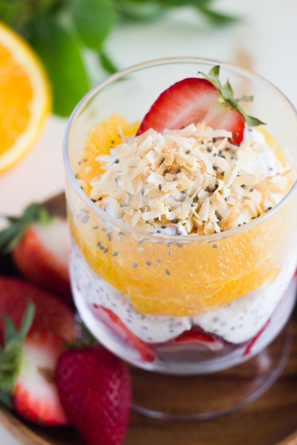 Toasted Coconut Chia Yogurt Fruit Parfait in a glass cup.