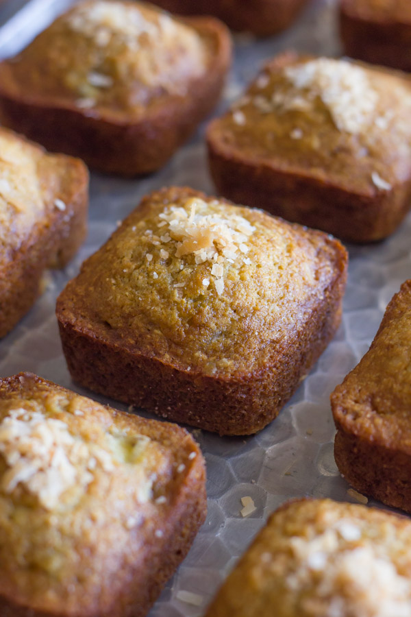 Whole Wheat Toasted Coconut Banana Muffins on a serving platter.