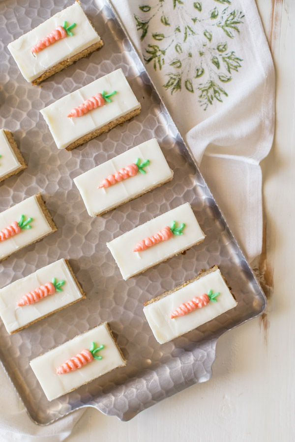 Carrot Cake Bars with Cream Cheese Frosting arranged on a serving tray.