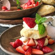 These Homemade Strawberry Shortcakes have a slightly sweetened fluffy buttermilk biscuit with red ripe strawberries and freshly whipped cream!