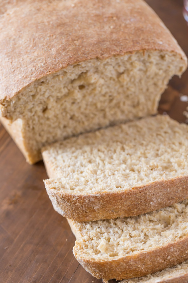 Easy Honey Whole Wheat Bread loaf that has been sliced.