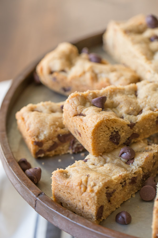 Peanut Butter Chocolate Chip Cookie Bars arranged on a cake stand.