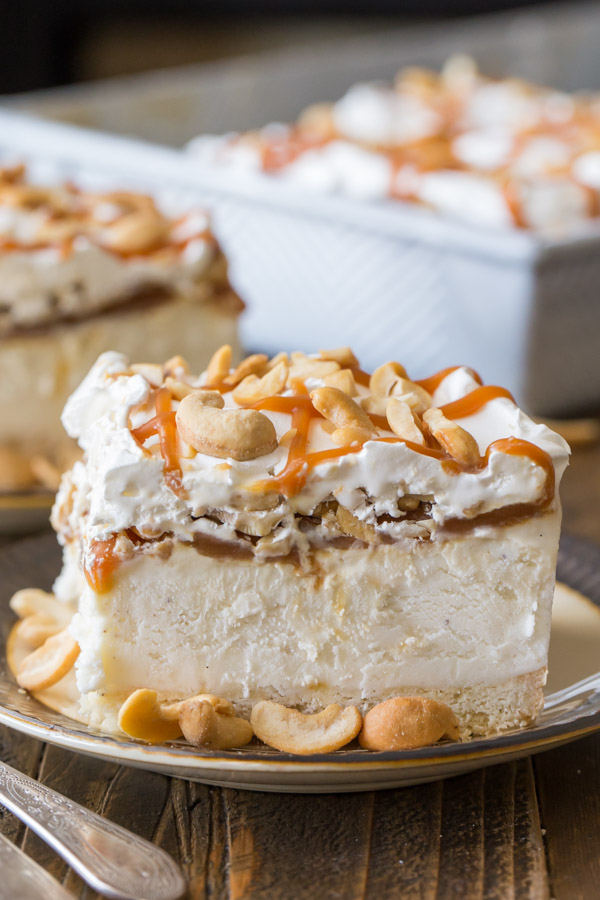 Caramel Cashew Ice Cream Dessert - Creamy vanilla ice cream on a shortbread cookie crust, topped with homemade caramel sauce and cashews of course!
