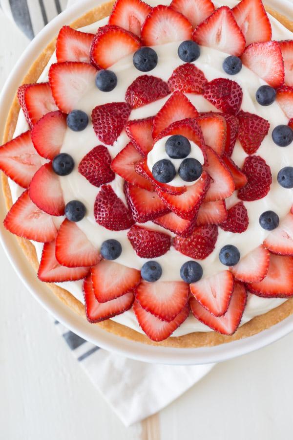 Strawberry Cream Cheese Tart on a cake stand.