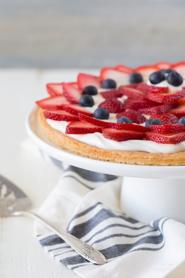 Strawberry Cream Cheese Tart on a cake stand.