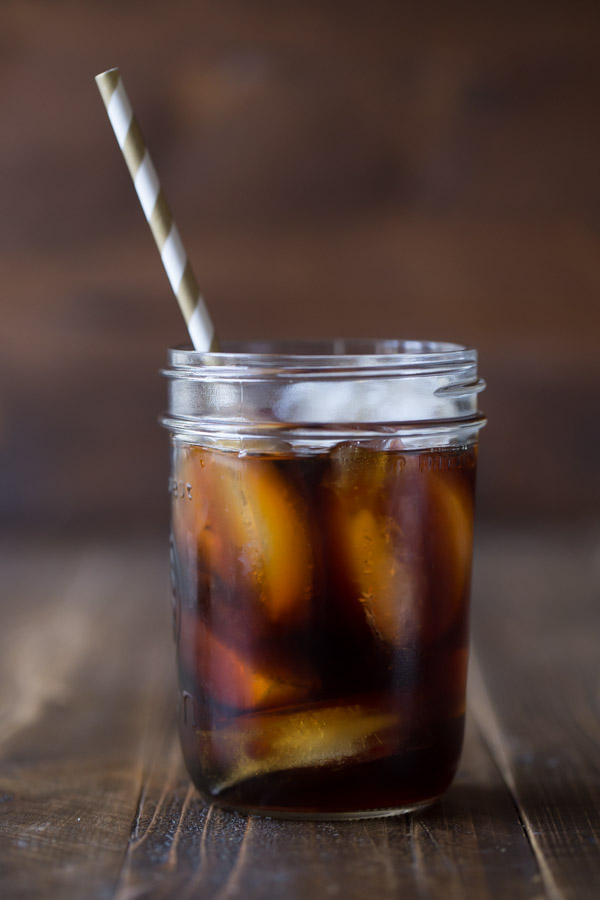 Cold Brew Iced Coffee in a glass jar with a straw.