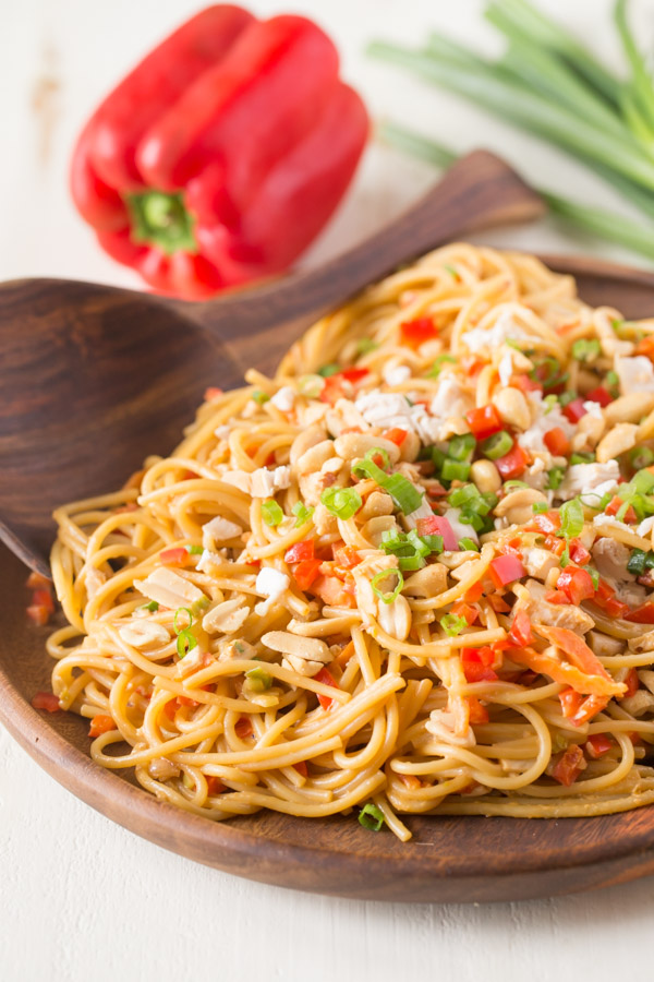 Easy Spicy Peanut Noodles With Chicken - Some pantry staples, a few fresh veggies and the help of a rotisserie chicken make this quick and easy dinner a huge hit!