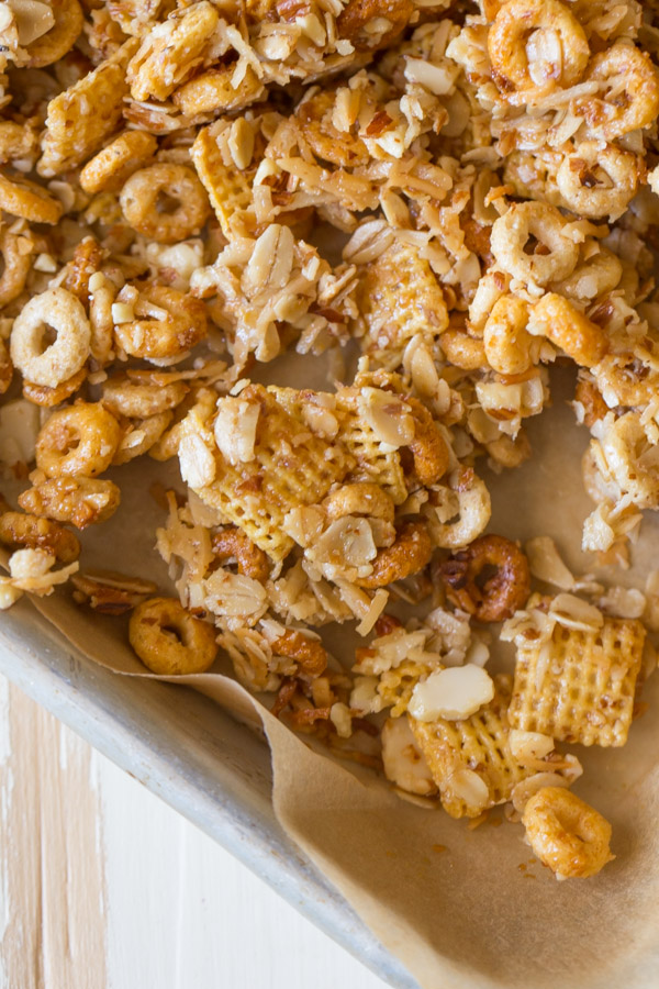 Healthier Coconut Almond Chex Mix on a parchment paper lined baking sheet.