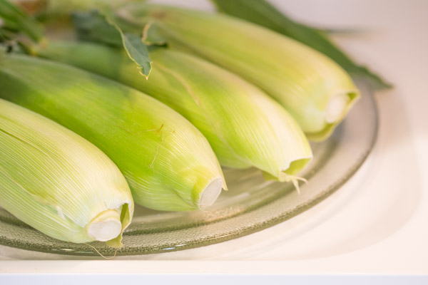 How To Cook Corn on the Cob in the Microwave - I love this method because it's so fast and the silk slides off the kernels much more easily!