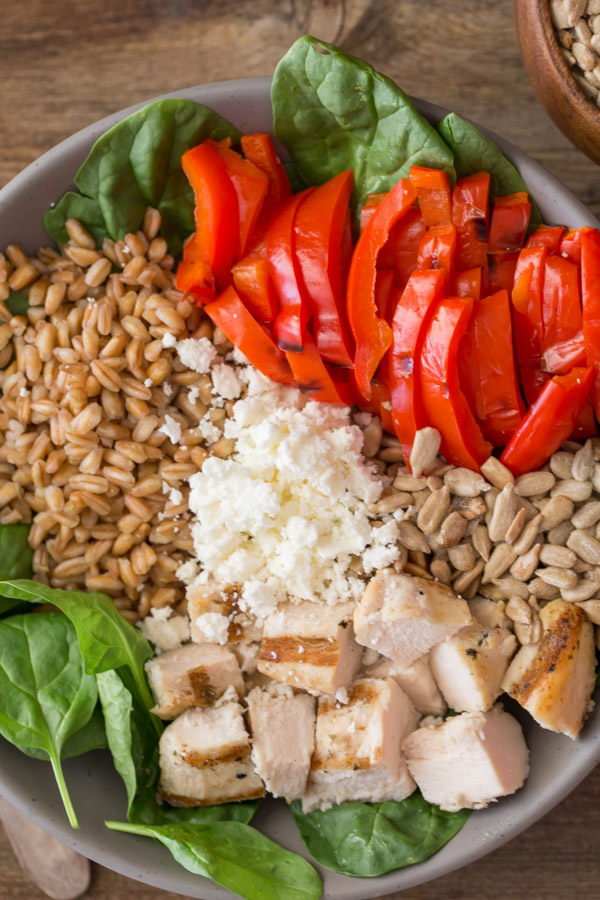 Grilled Chicken and Red Pepper Power Bowl ingredients arranged in a bowl.