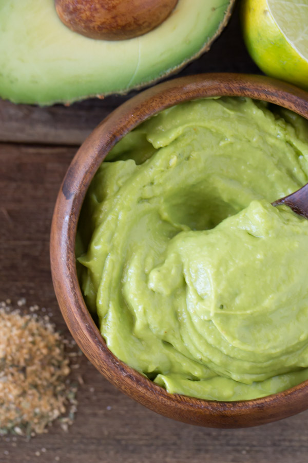 Whipped Avocado Cream in a small wood bowl.