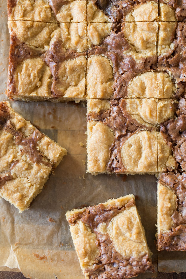 Peanut Butter Cookie Brownies being cut into squares.