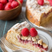 Raspberry Almond Coffee Cake - Layers of moist almond cake, sweetened cream cheese, raspberry preserves and an almond streusel topping.