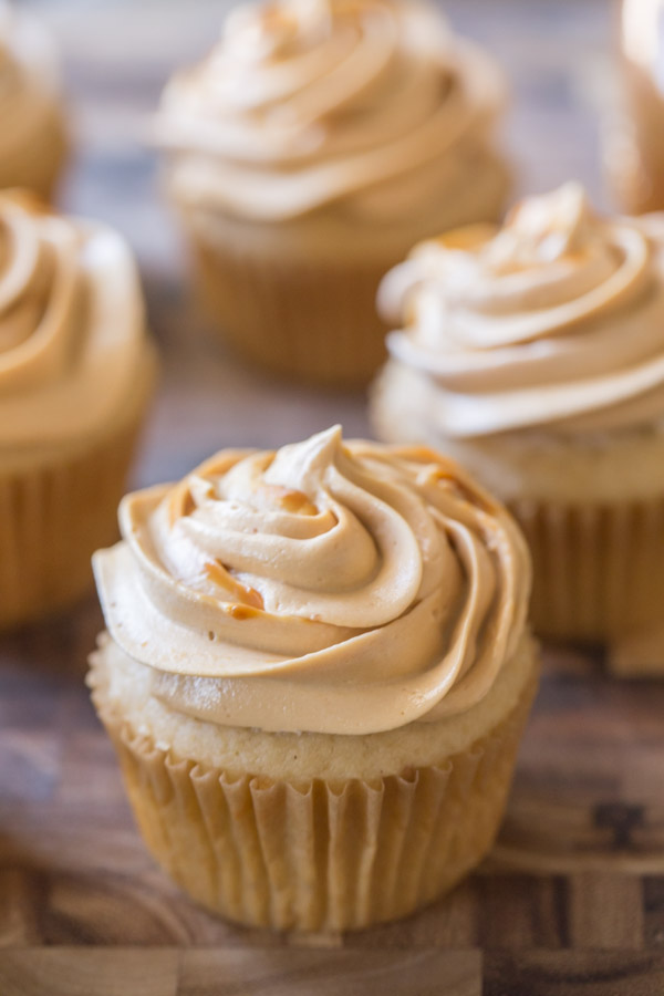 Apple Cupcake With Dulce De Leche Buttercream, with more cupcakes in the background.