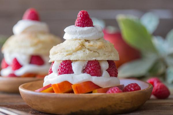 Raspberry Peach Shortcakes assembled on wood plates.