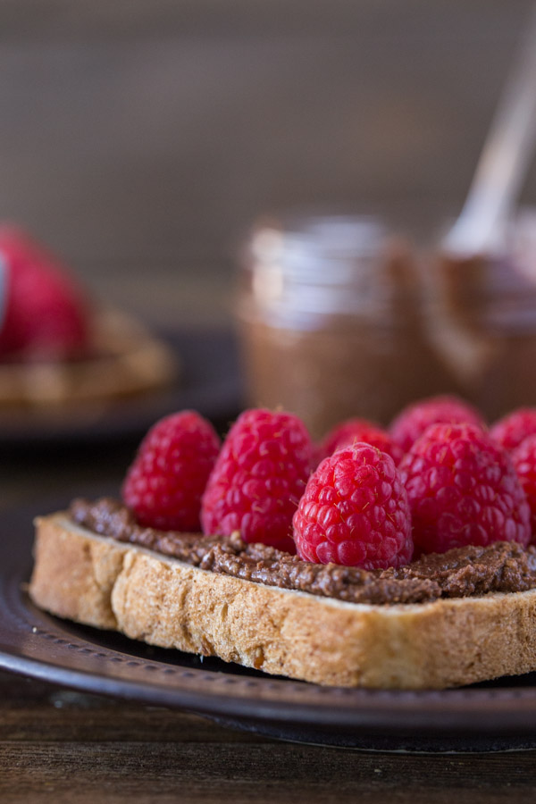 Chocolate Hazelnut Raspberry Toast - Homemade chocolate hazelnut spread on toast with fresh raspberries and powdered sugar.